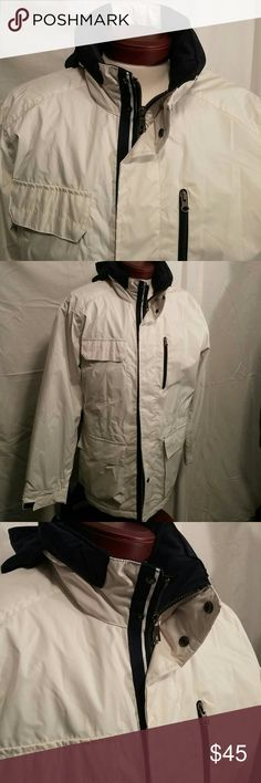 Nautica men's rain and wind jacket Excellent like new Nautica men's jacket. Be protected from the wind and the rain with this awesome weather proof jacket with a warm polar fleece inside. Off white with navy blue trim. Perfect for boating or sailing. Lots of pockets. Nautica Jackets & Coats