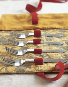 Delight your recipients with a gift of vintage flatware, wrapped in a holder sewn by you. Just one large piece, such as a cake server, is also nice. Choose fabrics in jewel tones, or a royal blue; the silverware will glow!