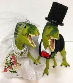 The cutest dinosaur wedding cake toppers ever! Bride includes a handmade wedding gown, necklace, garter and bouquet.  Groom includes a handmade tux, top hat and bow tie color of your choice.