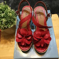 Jaclyn Smith Sandals Cute red sandals, has a rose in the front, only used a few times, excellent condition, still in the box. Jaclyn Smith Shoes Wedges