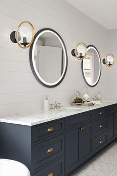 The Reflections Round Wall Mirror features a smart touch dimmer switch allowing you to control the amount of light desired. Modern Farmhouse Lighting, Mirrors For Sale, Wood Chandelier, Market Baskets, Round Wall Mirror, Mirror With Lights, Oil Rubbed Bronze, Reflection, Condo