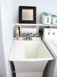 jen at frame fanatic has made some great changes and organization with her new laundry room - Bathroom Utility Sink