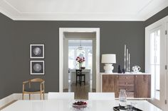 Adding an organic feel to any room, this warm gray shade by Kelly-Moore came out on top in a survey of 15,000 members from the American Society of Interior Designs. Color: Kettleman KM5818