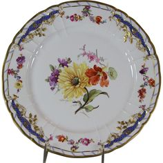 Ref. # 130126 64  Description : Collectors Cabinet Plate, Hand-Painted multi-colored flowers  Pattern : Breslau 64  Shape : Rocaille  Size : 10 in. 26