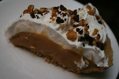 Crockpot Caramel Pie -     2 (14 ounce) cans sweetened condensed milk      1 graham cracker crust      Whipped topping      Chopped chocolate morsels      Chopped salted peanuts