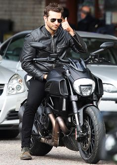 Man in black! A tough-looking Bradley Cooper rode a hog through the streets of London as he filmed Adam Jones.