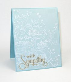 handmade card ... for Moxie Fab Tuesday Trigger: A Little Romance ... pastel blue card ... vellum cover stamped in white with Leafy Vines stampe of leaves and tendrils ... script font ... sentiment embossed in gold ... fabulous card!! ... great interpretation of the photo ...