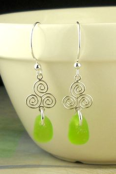 Beautiful Sterling Silver, triple spiral earrings reminiscent of the ancient Celtic spiral pattern with rare and genuine lime green sea glass gems! Gorgeous French hoop earrings in all .925 Sterling S