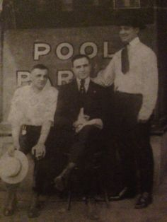 Picture take of Al Capone on his graduation day before his scar.  His father Gabriel sitting to the left of him.  (From the book Uncle Al by Deirdre Capone)