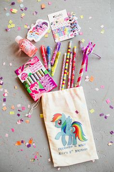 Adorable drawstring bags from Sweet Lily's Confections and asked if she could personalized. Filled the bags with inexpensive little trinkets like crayons, bubble bath, pencils and custom hair ties by Enchanted Hair Ties.