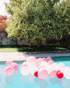 """We wanted to fill the pool with a pop of color and balloons seemed like the most fitting way to do so,"" this bride shared. ""I love them because of the happiness and nostalgia tied to them. They make everyone smile."""