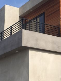 Smooth Stucco. Light Grey. Wood Trim.