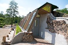 beautiful side view of an established, well-blended earthship home