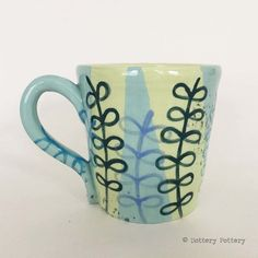 This handthrown pottery mug is made from white earthenware clay. It has been thrown on the pottery wheel and decorated using various techniques with colour and pattern. The mug has been finished in a clear, glossy glaze (food safe). It has been fired t. Handmade Design, Handmade Crafts, Crafts To Make, Arts And Crafts, Hand Thrown Pottery, Earthenware Clay, Pottery Wheel, Pottery Mugs, Summer Flowers