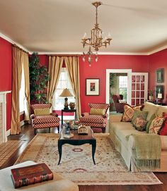 A traditional living room with red walls