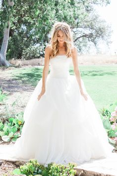 A fluffy tulle ballgown. Photography : Gloria Mesa Photography Read More on SMP: http://www.stylemepretty.com/california-weddings/simi-valley-california/2016/08/05/chilean-cutlure-quail-ranch-wedding/