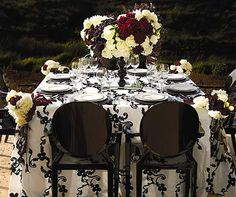 White and Black Ribbon Taffeta fabric from Resource One Linens with black Louis Ghost chairs.