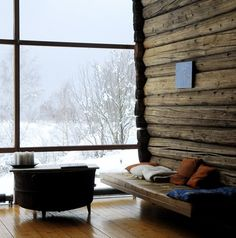 log beam wall, window looking out to snowy goodness. just need a fireplace to call it perfect