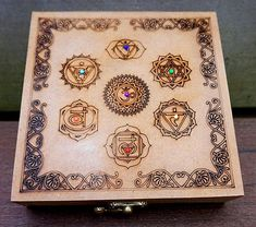 Chakra Boxes with a set of chakra stones inside http://www.thesacredfeminine.com/chakra-box.html