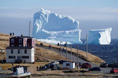 """Residents view the first iceberg of the season as it passes the South Shore, also known as """"Iceberg Alley"""", near Ferryland Newfoundland, Canada April 16, 2017."""
