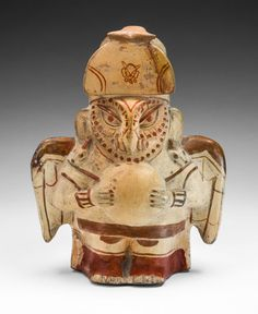 Moche North coast, Peru  Vessel in the Form of an Owl Impersonator, 100 B.C./A.D. 500  Ceramic and pigment 23.5 x 18.4 cm (9 1/4 x 7 1/4 in.)