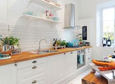 Butcher block and white kitchen, love!
