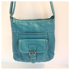 """Red by Marc Ecko Turquoise Cross Body Bag Buttery soft faux leather in a beautiful turquoise color. Only used once! Exterior has a pocket that snaps closed and an open compartment behind. Interior is trademark red color with a large elasticized slip pocket and a zippered side pocket. Strap is adjustable. 10"""" tall, 9.5"""" wide, 2.5"""" deep. Marc Ecko Bags Crossbody Bags"""