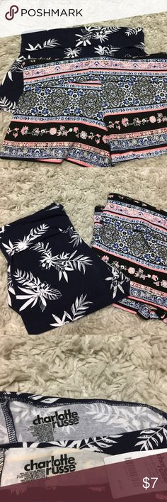 Cotton Printed Bodycon Shorts Bundle Printed cotton shorts from Charlotte Russe. Form fitting, fit like spandex. Navy blue pair worn once. Pink pair never worn (with original tags). Both size Large. Charlotte Russe Shorts