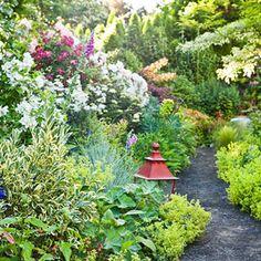 Creative chaos rules this Portland garden  http://www.traditionalhome.com/gardens/beautiful-gardens/garden-retreat?page=0