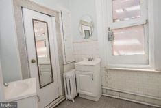 4629 Spruce St, Philadelphia, PA 19139 | MLS #PAPH914198 | Zillow Stacked Washer Dryer, Washer And Dryer, Brick Detail, Chair Rail Molding, Open Stairs, Retro Bathrooms, Fire Escape, Large Homes
