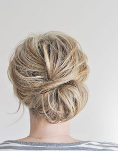 Pull your hair back into a low chignon with this tutorial. #beauty
