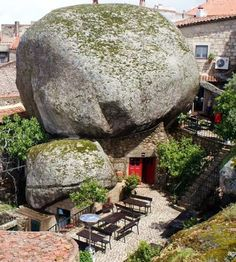 "Monsanto is a beautiful Portuguese village built on the side of a mountain. Local houses are squeezed between huge boulders and narrow streets are carved from the rock. It was named ""the most Portuguese village in Portugal"" in 1938"