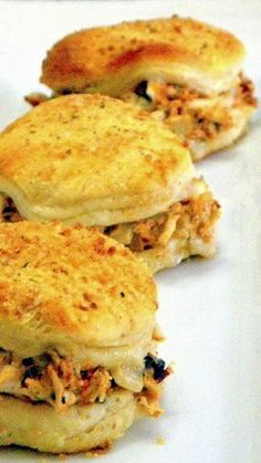 Fast and Easy Chicken Spread Sliders ala Hungry Harps... And indeed these are FAST EASY and they are delicious.. they are a bit sneaky, as they use refrigerator biscuits and meat from a store bought fully cooked rotisserie chicken.  These are FANTASTIC and over 10,000 pinners love em!