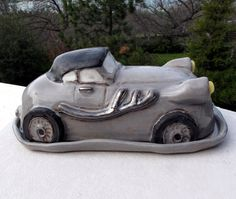 Doug made this with just a little help from me. Completely original and his own design, modeled after a fantasy roadster. Absolutely one of a kind. Can be used as an actual butter dish or just displayed as a sculpture. Return to my main shop page here http://www.etsy.com/shop/jillatay