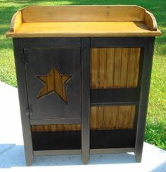Primitive Star Bead-board Cabinet  the color im planning on doing my new coffee table in :)