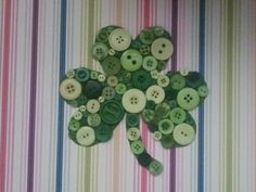 Shamrock button art. I found the buttons at Jo-Ann and picked a piece of scrapbook paper more to my liking. The hardest part was figuring out the placement of the buttons; the smaller ones run out fast because they're so versatile, so watch out!