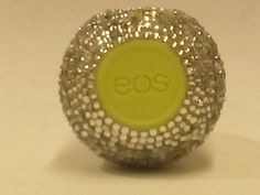 Beautiful Decorative EOS Lip Balm. EOS Lip Balm is 95% organic and 100% Natural. I've taken this wonderful New Popular product to the next level. RHINESTONE BLING. You will love it and your friends will be jealous!!! You choose the flavor. This product is made to order. I need two weeks to finish and ship. I presently have Strawberry Sorbet with Pink Stones.