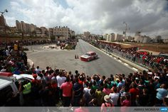 RAMALLAH : A Palestinian driver takes part in a race, organized by the Palestinian Federation of Cars and Motorcycles Sports, in the West Bank town of Ramallah, on September 20, 2013. AFP PHOTO/ABBAS MOMANI