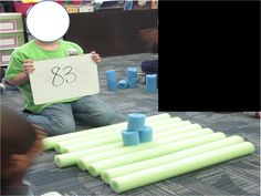 First Grade Fairytales: Tens and Ones So smart!! Using pool noodles as giant base ten manipulatives.  Great idea!