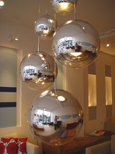 Mirror Ball suspension light by Tom Dixon. Made of plastic polycarbonate, the globe is metalised with real chrome metal, creating a mirror finish. Also available as standing lights, table lights, wall lights and floor lamps.  Previously on display in our Hove Store.