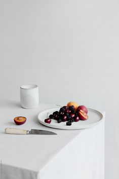 Platter of summer fruit on table