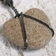 wire-wrapped stone.....or pottery shard or sea glass?