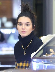 Natural beauty: Kendall's chestnut tresses were swept up in a high messy bun and she opted for barely there make-up, allowing her flawless complexion to take centre stage