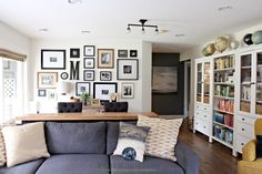 Family room with photo gallery wall, gray sectional, ikea hemnes white bookcases. Sherwin Williams Creamy and home decor. Kylie M Interiors Colour expert and Canadian e-design blogger