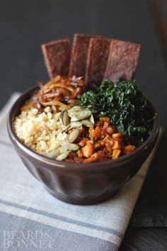 Here's a vegan bowl you're going to crave... Fall Harvest Bowl with millet, kale, spicy roasted butternut squash and caramelized onions