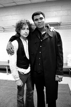 Bob Dylan backstage with Muhammad Ali at Madison Square Garden during the Rolling Thunder Revue, 1975. (Ken Regan/Vanity Fair)