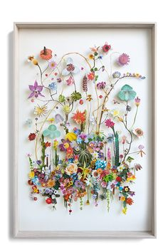 3 d collage of  cutout flower prints and dried flowers.