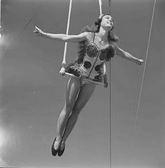 Flying trapeze vintage style! there is a place in denver...who's interested?