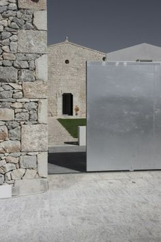 Casa SC by Francesco Nicita The barn has been updated to become the contemporary wing, while the original stone of the old warehouse were re...