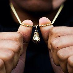 (1) Fancy - Caviar Cartel Figa Fist Necklace